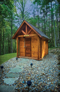 Externior photo of a standalone log sauna.